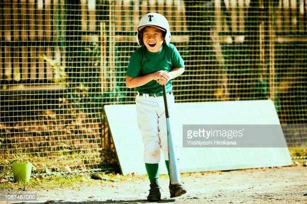 Smiling baseball boy talking next batter.