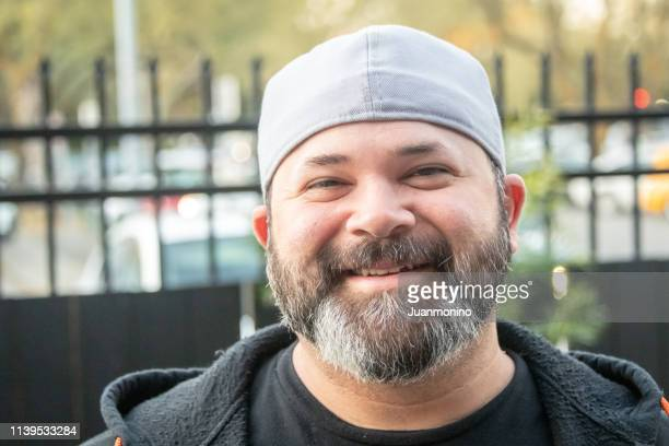smiling bearded man - minority groups stock pictures, royalty-free photos & images