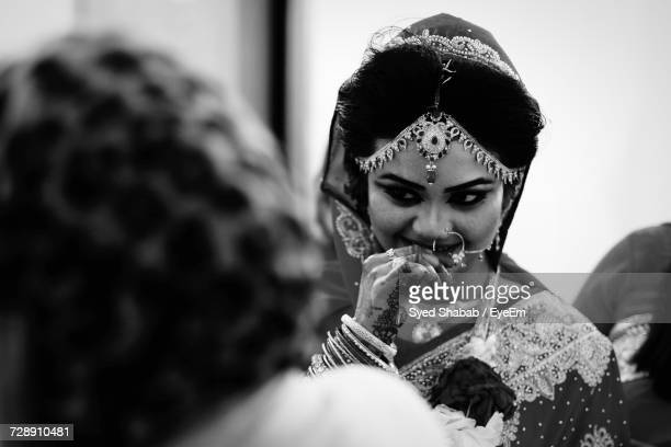 smiling beautiful bride in wedding ceremony - bangladeshi bride stock photos and pictures