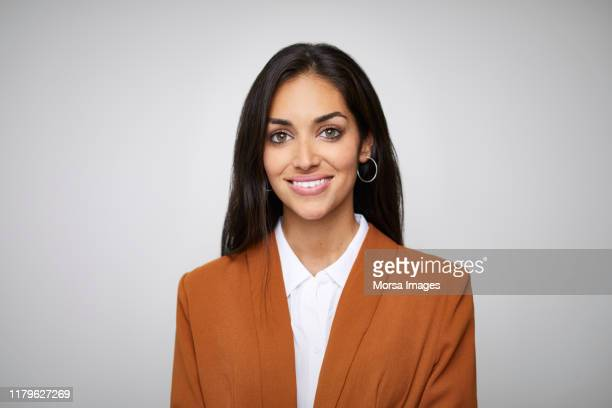 smiling beautiful female ceo with hazel eyes - smart casual stock pictures, royalty-free photos & images