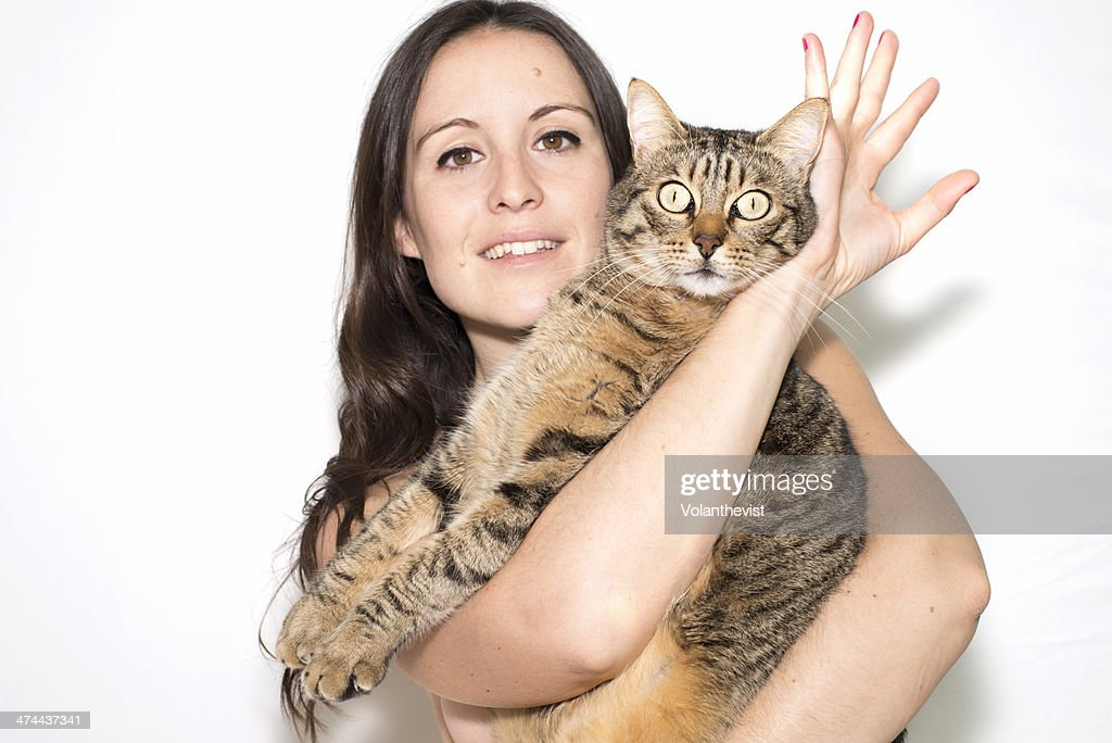 Smiling Beautiful Woman Holding A Cute Cat High Res Stock Photo Getty Images