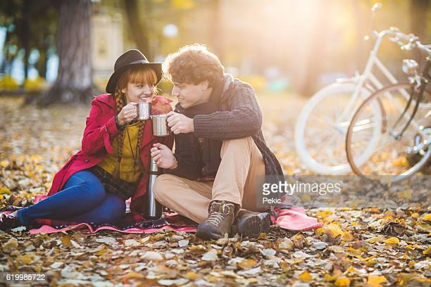 Smiling bike riders enjoy autumn