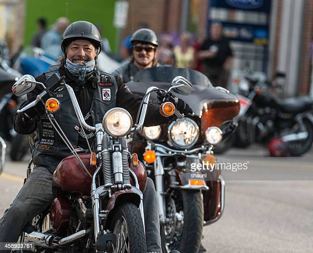 smiling bikers - harley davidson stock pictures, royalty-free photos & images