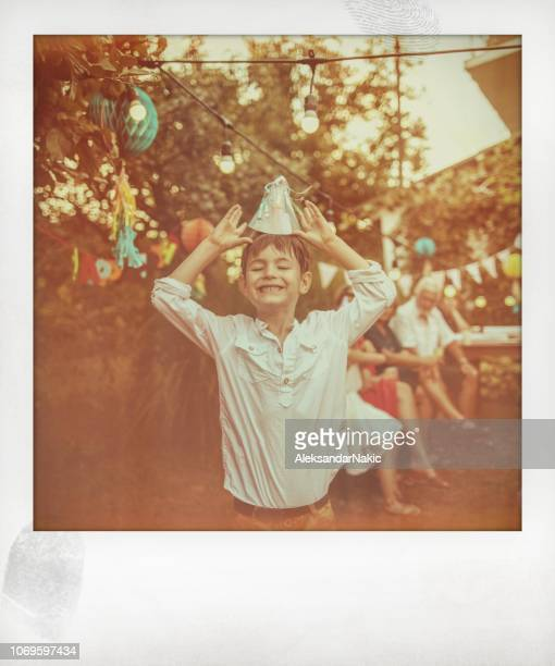 smiling birthday boy - polaroid stock pictures, royalty-free photos & images