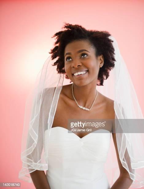 Smiling Black bride in wedding dress