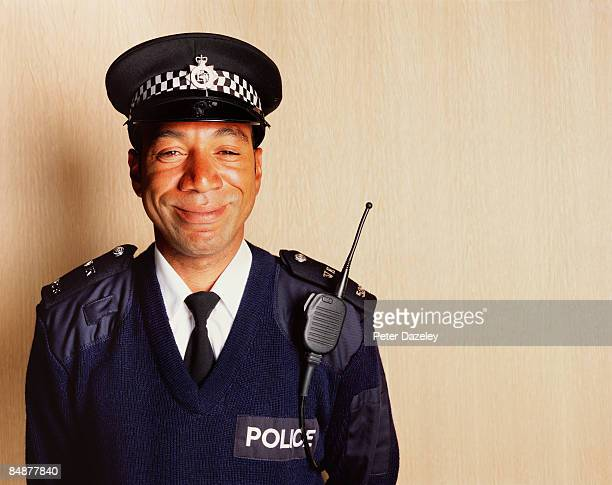 smiling black british police constable - police force stock pictures, royalty-free photos & images