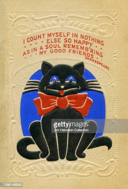 Smiling black cat with a red bow sits beneath a Shakespeare quote, circa 1906.