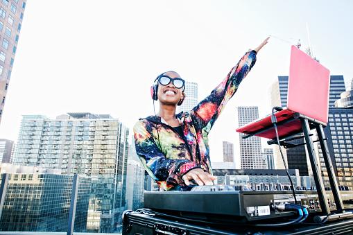 Smiling Black DJ on urban rooftop - gettyimageskorea