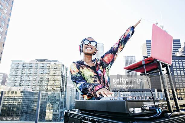 smiling black dj on urban rooftop - dj stock pictures, royalty-free photos & images