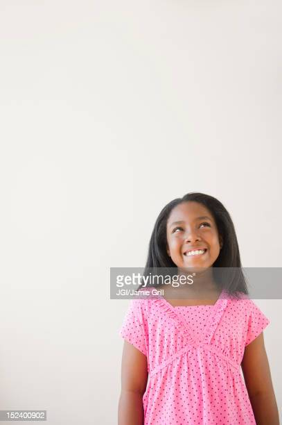 Smiling Black girl looking up
