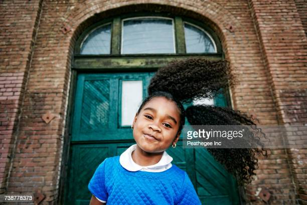 smiling black girl tossing hair - 6 7 years photos stock photos and pictures