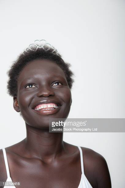 Smiling Black woman in tiara