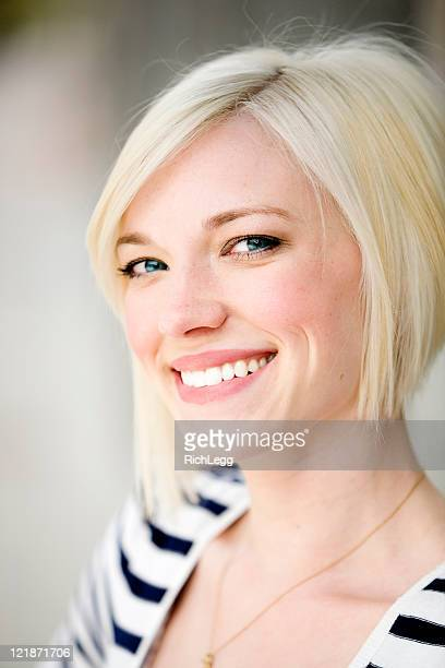 smiling blond woman - rich_legg stock pictures, royalty-free photos & images