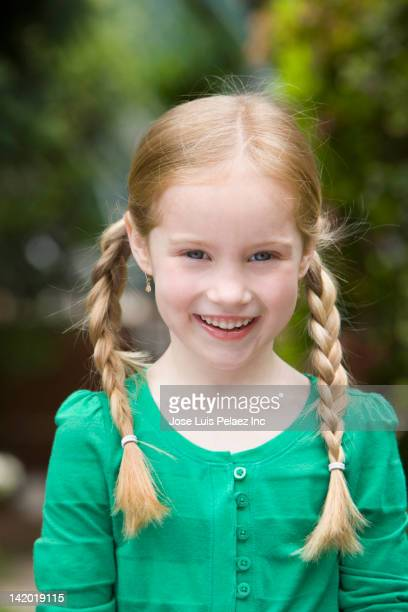Smiling blonde girl with braids