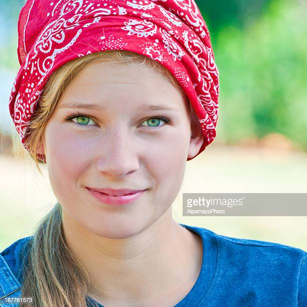 smiling blonde teen girl with red bandana - vi - green eyes stock pictures, royalty-free photos & images