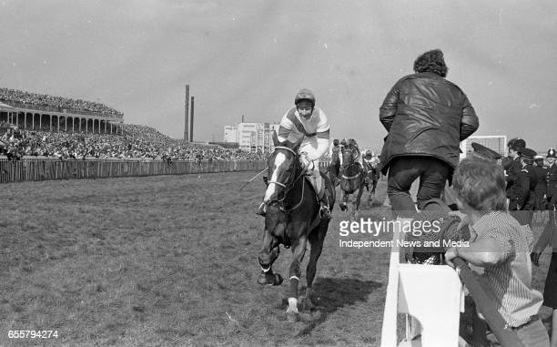 A Smiling Bob Champion and Aldaniti past the post to win the Sun Grand National Chase from Spartan Missile M Thorne