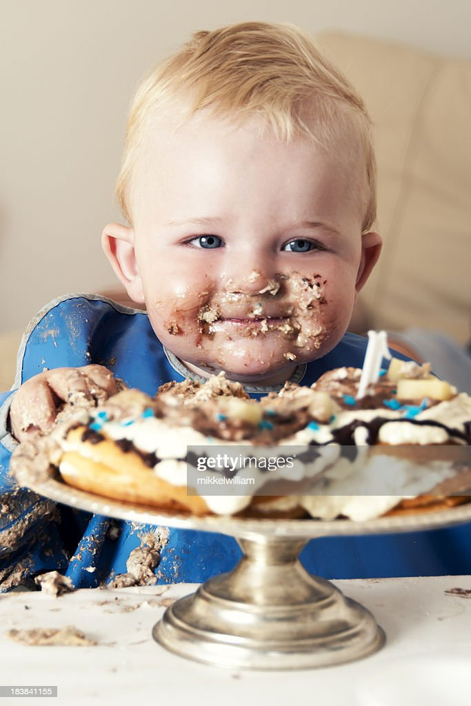 Smiling Boy Eats A Big Cake Stock Photo Getty Images