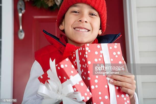 Smiling boy holding christmas present