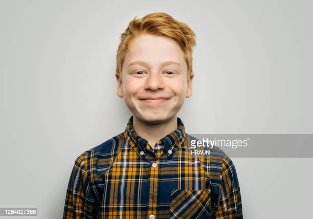 smiling boy in casuals against white background - boys stock pictures, royalty-free photos & images