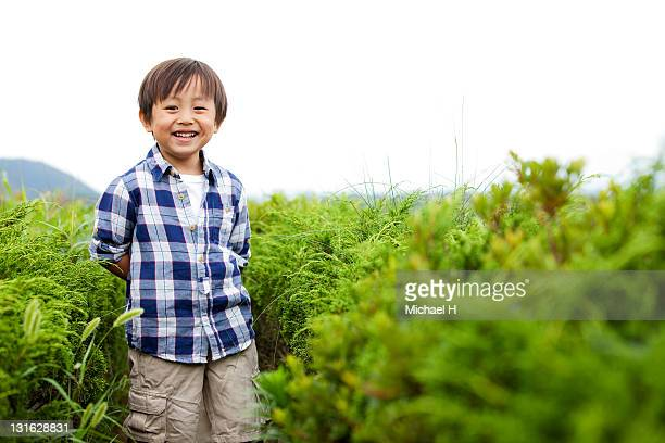 Smiling boy in the meadow