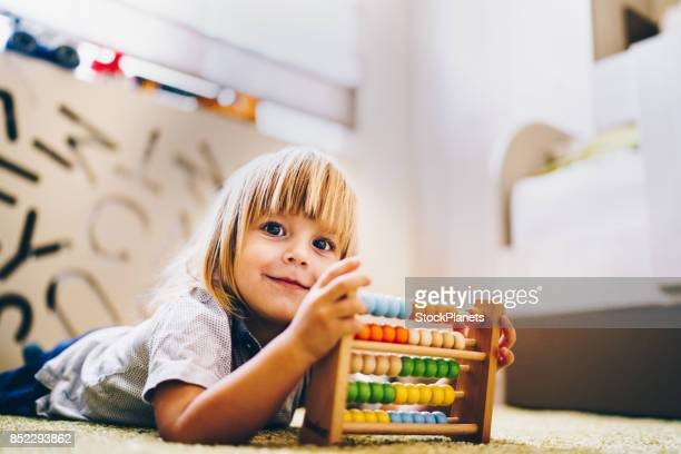 smiling boy is playing with toy