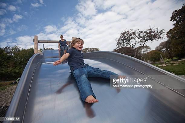 Smiling boy on slide