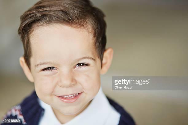 Smiling boy outdoors, portrait