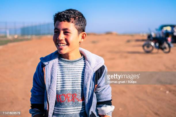 smiling boy - iraq stock pictures, royalty-free photos & images