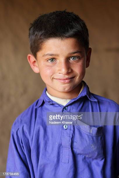 smiling boy - pakistani boys stock photos and pictures