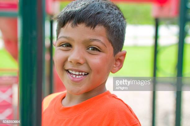 smiling boy - human joint stock pictures, royalty-free photos & images