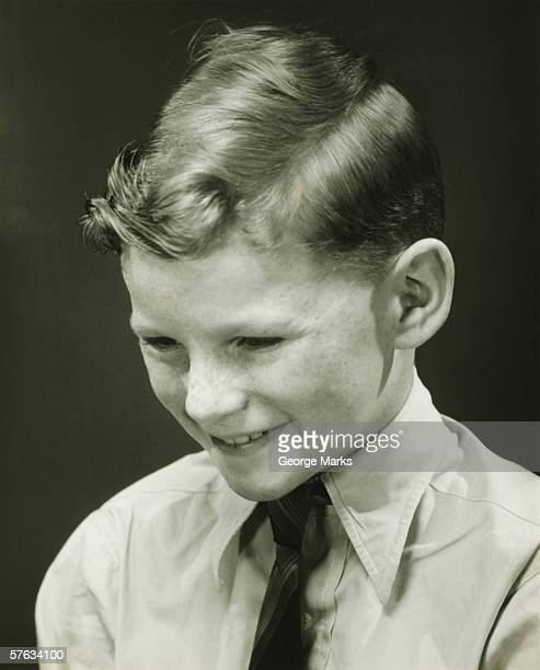 smiling boy (10-11) posing in studio, (b&w), portrait - hair parting stock photos and pictures