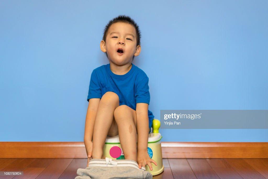 Smiling boy potty training : Stock Photo