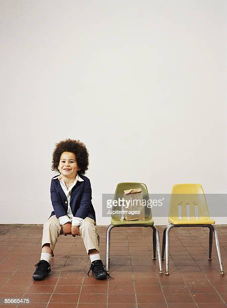 Smiling boy sitting on chair