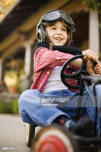 Smiling boy steering go-kart