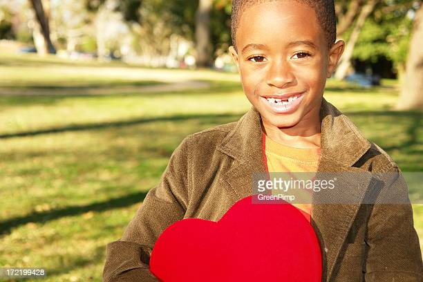smiling boy valentine - valentines african american stock pictures, royalty-free photos & images