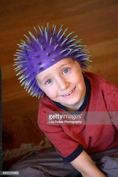 Smiling boy wearing sea urchin hat