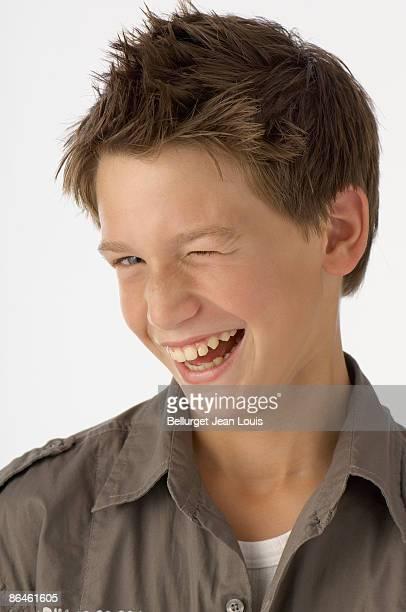 Smiling boy winking