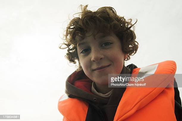 Smiling boy with a lifejacket