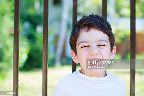 Smiling boy with closed eyes