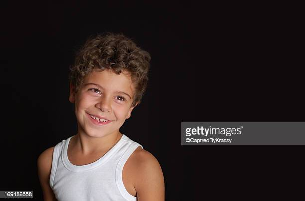 Smiling boy with curly hair