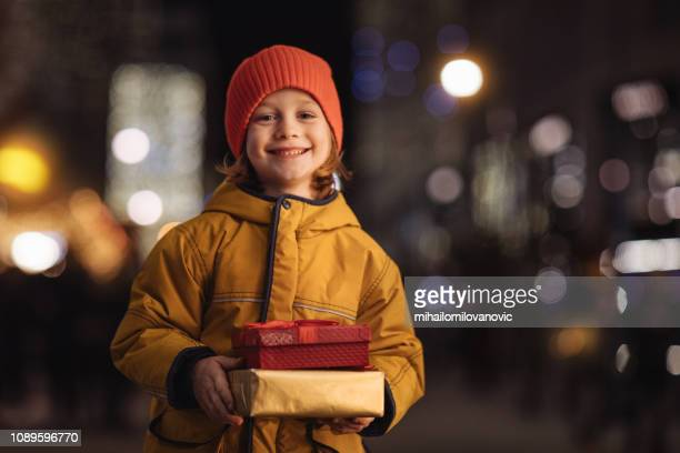 Smiling boy with gifts