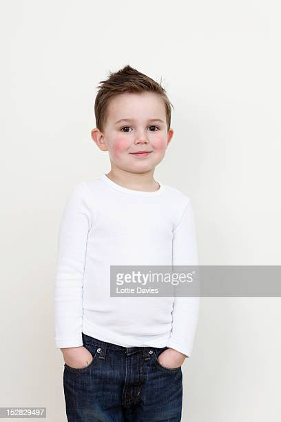 Smiling boy with hands in pockets
