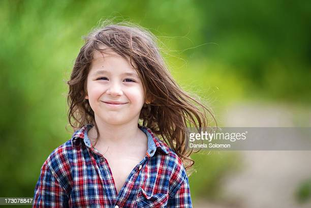 Smiling boy with long hair