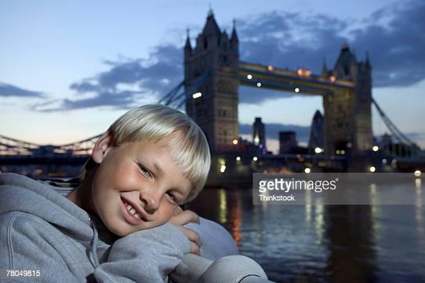 Smiling boy with Tower Bridge background, London, England