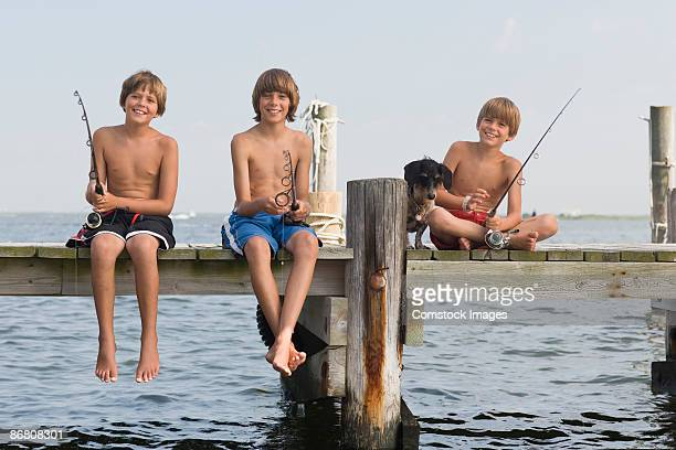 Smiling boys fishing together