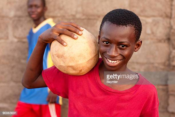 Smiling boys with soccer ball