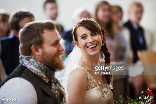 Smiling bride and groom at their church wedding.
