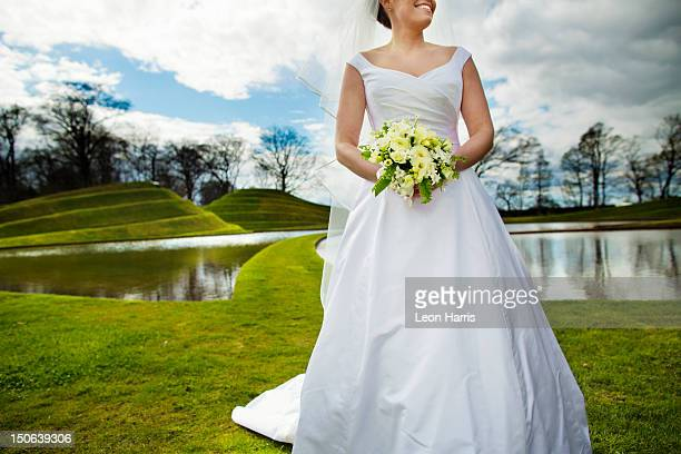 Smiling bride walking in field