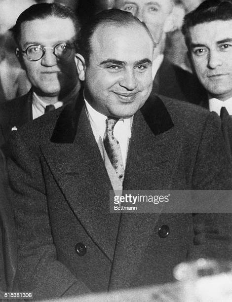 Smiling broadly and somewhat disdainfully Scarface Al Capone was arraigned in Chicago Municipal Court on a charge of being a 'Common Vagrant' Already...