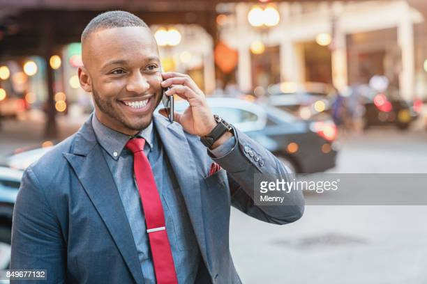Smiling Business Commuter talking on Mobile Phone